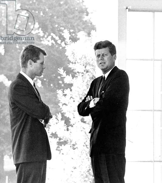Attorney General Robert Kennedy whose duties include enforcement of Federal civil rigths laws, consults with brother President John Kennedy at the White House in 1962 (?)