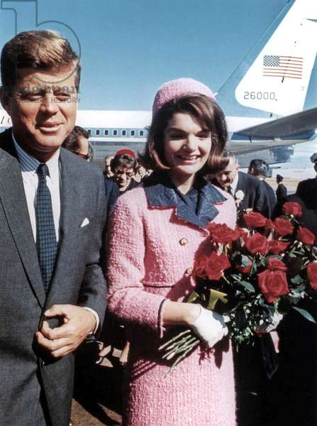 President John Kennedy and his wife Jackie, wearing strawberry-pink Chanel suit , arriving at Dallas airport (the day of John's assassination) November 22, 1963