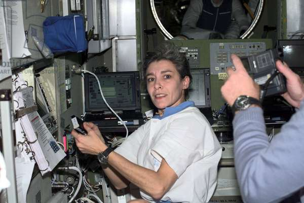French Flight Engineer Claudie Haignere, works in the Zvezda Service Module on the International Space Station (ISS)